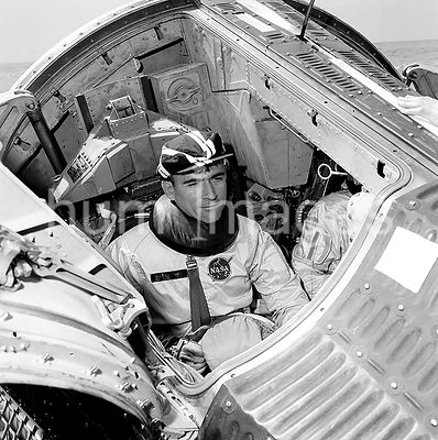 (24 Feb. 1965) --- Astronaut John W. Young,  Gemini-Titan 3 , is shown making a final check of spacecraft systems prior to be...