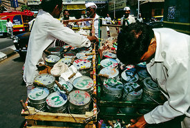 Dhaba Wallahs, Bombay, India. Dhaba Wallahs deliver packed lunches to office workers in the city every day