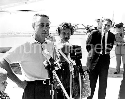 (21 July 1961) --- Astronaut Virgil I. (Gus) Grissom and his family are shown at the airport at Patrick Air Force Base with N...