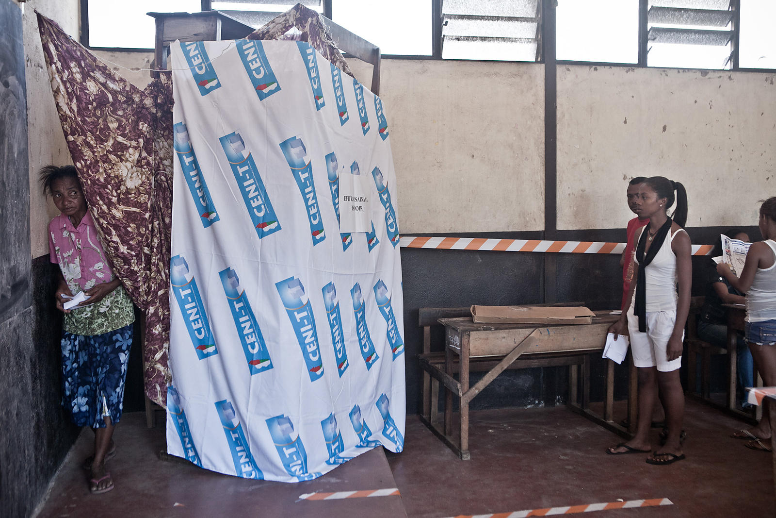 People prepare to vote at a polling station in Tamatave, on the eastern coast of Madagascar, on October 25, 2013. Madagascar ...