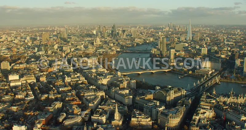 Aerial footage showing Covent Garden, the Strand and panning across to the South Bank