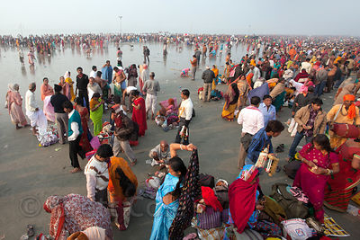 Pilgrims bathe in the Bay of Bengal at the Gangasagar Mela (Festival), a pilgrimage to Sagar Island in India, where the Gange...