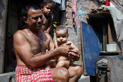 Grandfather and his baby boy in Salkia, Howrah, India