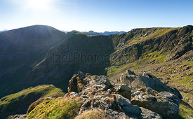 Sunrise over Ennerdale from Scoat Fell views of Pillar from In the English Lake District, UK.