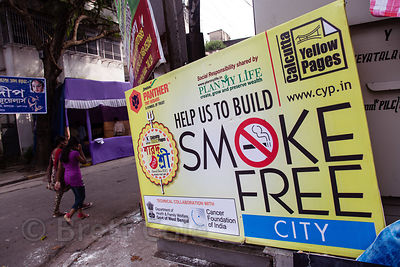 Anti-smoking sign in Gariahat, Kolkata, India. Tobacco use among men is epidemic in India, both cigarettes and chewing tobacco.