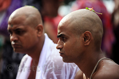 Hindu men with their heads shaved to honor deceased relatives during Mahalaya, Babughat, Kolkata, India