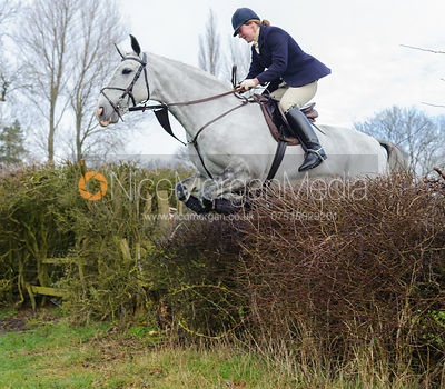 Maz Medcalf jumping the first hedge - Barleythorpe
