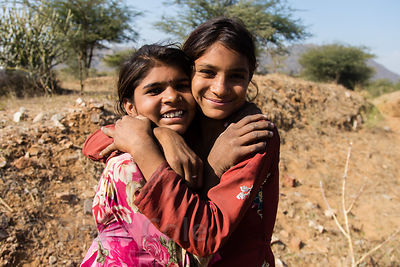 Girl friends take a break from herding their goats, Kharekhari village, Rajasthan, India
