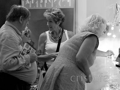 Jeweller chats up the husband while the wife chooses at the Hidden Art Design Fair at Godolphin