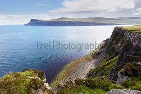 Cliffs and summit of Ben Skriaig across Loch Pooltiel near Dunvegan on the Isle of Skye, Scotland, UK.