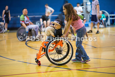 Young boy playing wheelchair rugby