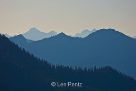 Blue ridges of the Cascade Mountains in early morning light, viewed from the Railroad Grade Trail, Mt. Baker–Snoqualmie Natio...