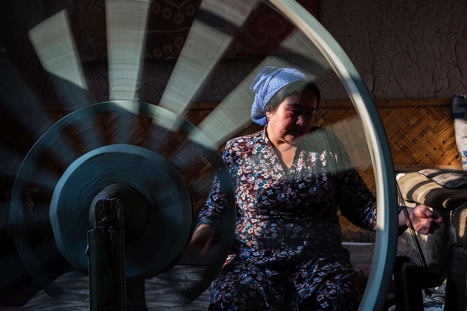 Woman Spinning Silk from Silkworm Cocoons in the Ancient Way of the Fergana Valley