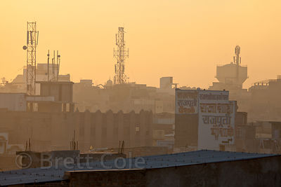 Sunrise over a water tank and radio towers in Jodhpur, Rajasthan, India