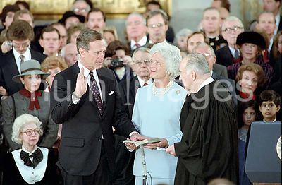 1/21/1985 Vice President Bush taking his oath of office with Justice Potter Stewart with Barbara Bush looking on in the US Ca...