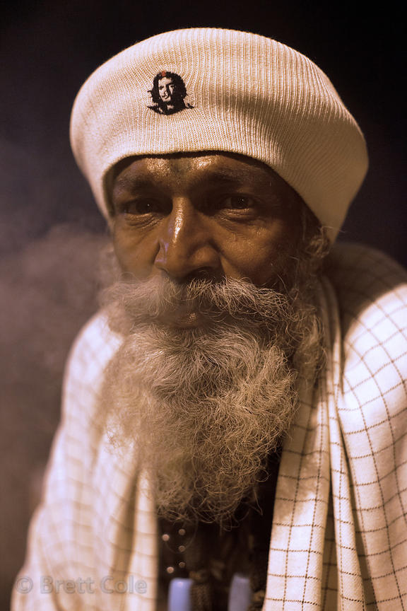 Portrait of an elderly man at night near Dashashwamedh Ghat, Varanasi, India.