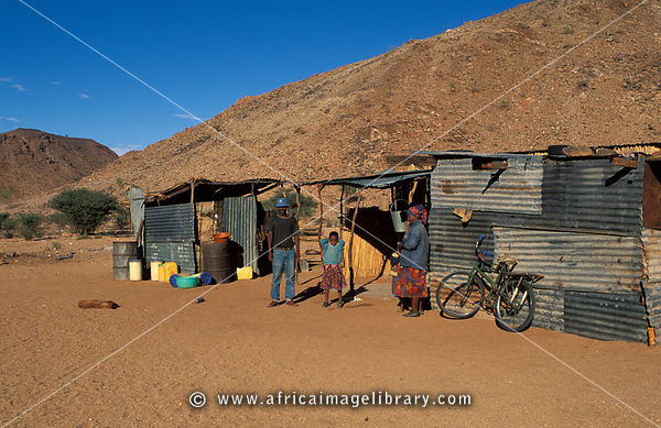 Corrugated iron shacks of resettled Nama people who returned here after the apartheid era, Riemvasmaak, Northern Cape, South ...