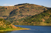 Rwanda, passenger boat on Lake Burera near Ruhengeri at the Virunga Mountains
