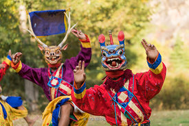Traditional Bhutanese dancers with costumes and masks in Paro, Bhutan.