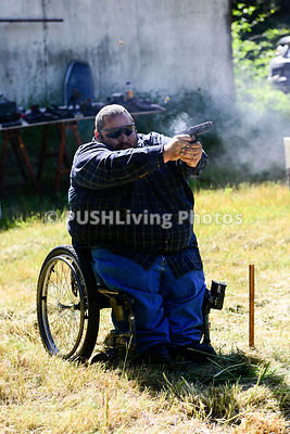 Man using a wheelchair on a shooting range
