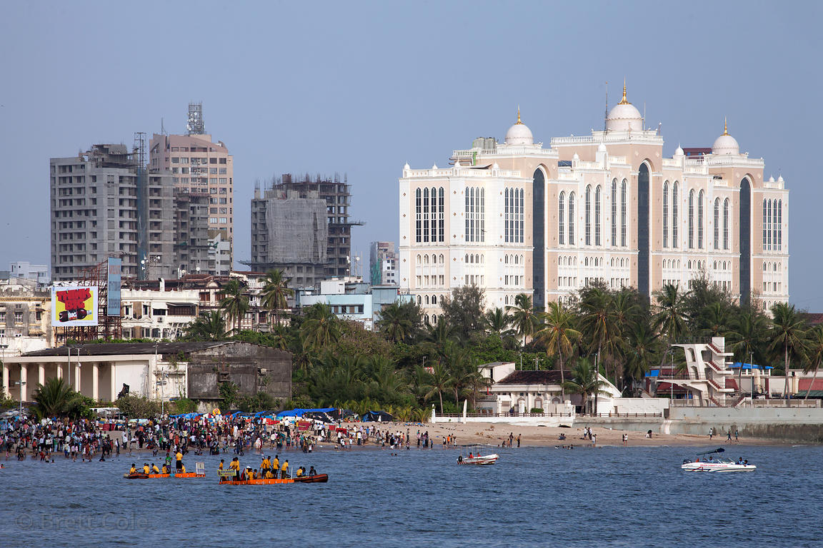A crowd gathers on Chowpatty Beach to immerse idols of Ganesh in the Arabian Sea during the Ganesh Chaturthi festival, Mumbai...