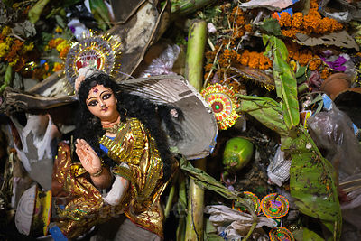 Idols pulled from the Hooghly River during Lakshmi Puja, Babughat, Kolkata, India.