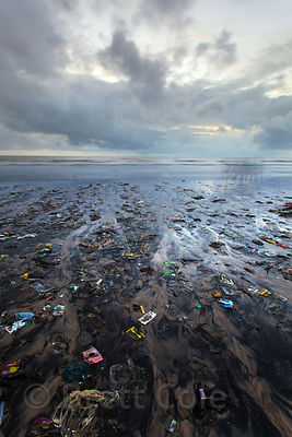 Dusk view of trash on Juhu Beach in Mumbai, India.