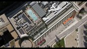 Aerial footage of Television Centre, White City‎, showing people swimming rooftop swimming pool at Soho House, London. people...