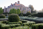 Formal garden planted with box, lavender, laurels and yew at Heale House, Middle Woodford, Wiltshire