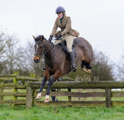 Harriet Gibson jumping a hunt jump from the meet