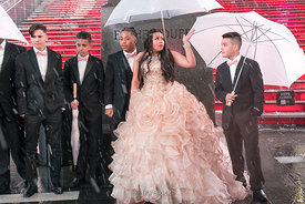 A bride poses with her groomsmen on a snowy day at Times Square, New York City