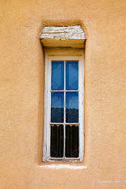 TURQUOISE TRAIL SAN FRANCISCO DE ASIS CHURCH WINDOW ADOBE STYLE ARCHITECTURE GOLDEN NEW MEXICO COLOR VERTICAL
