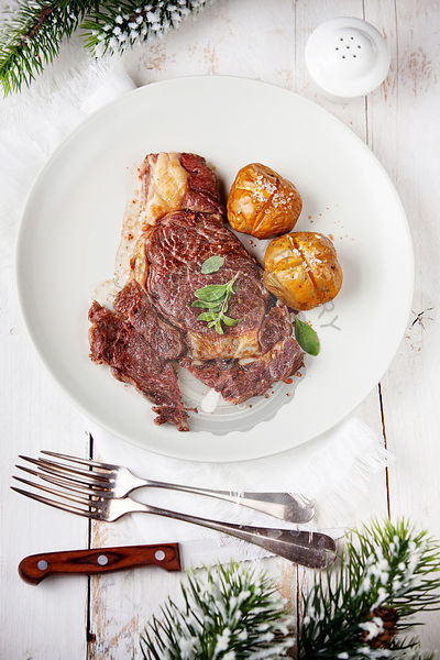 Ribeye Steak with Baked Potato on New Year's festive table