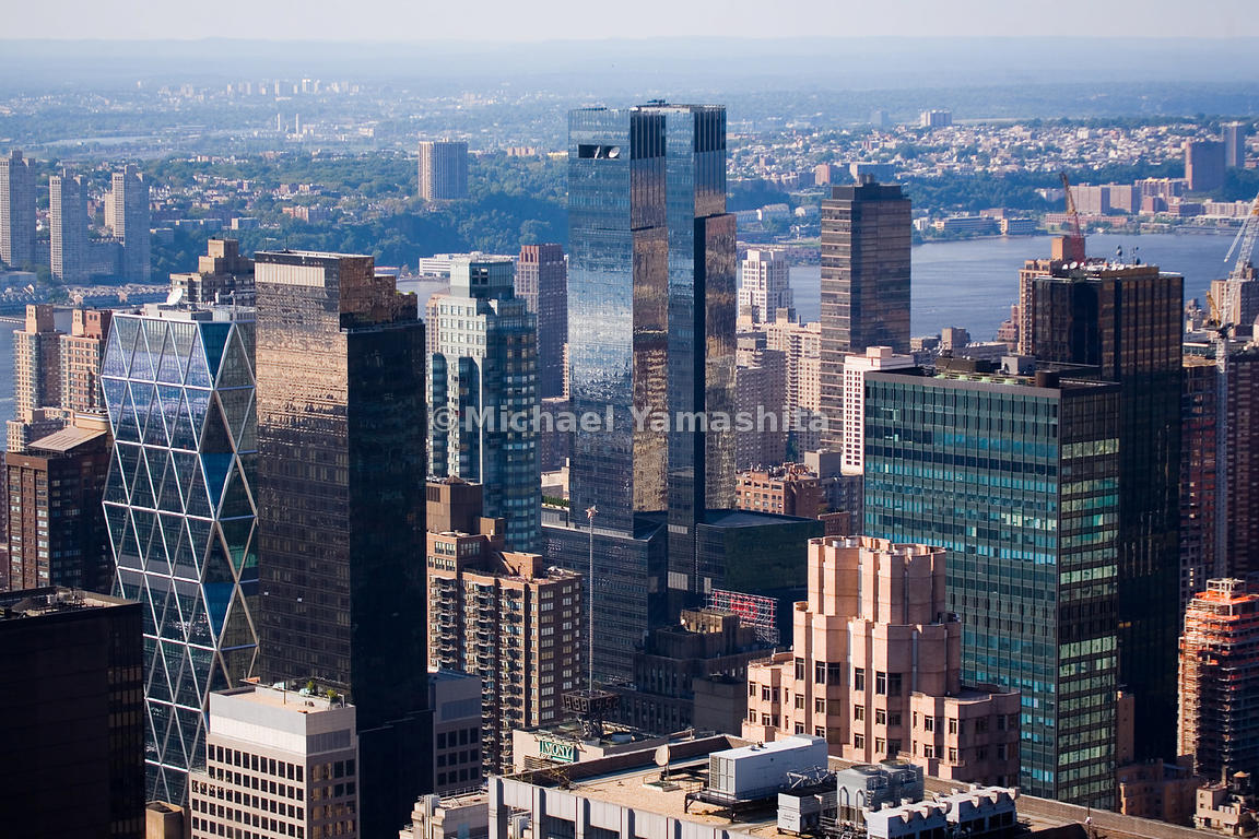 The Hearst Building, with its unique faceted frame, and the Time Warner towers (center) are part of a recent revival of the C...