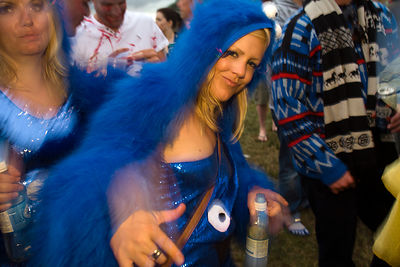 UK - Standon - A woman dances in a field at the Standon Calling Festival