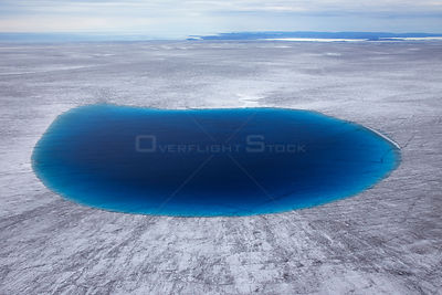 Aerial view of meltwater lake on the ice cap north-east of Sermeq Kujalleq Glacier. UNESCO World Heritage Site, Kalaallit Nun...