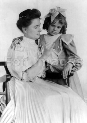 Helen Keller teaches a girl sign language