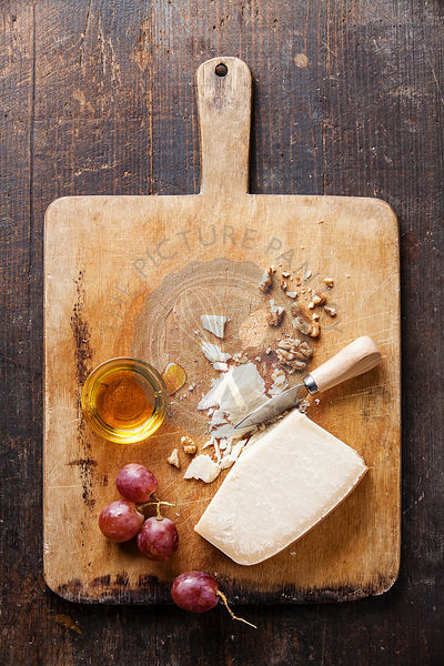 Parmesan cheese with honey, grapes and nuts