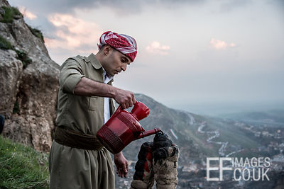 Man Pours Oil To Fuel Newroz Torches