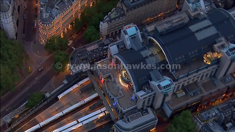 Aerial footage over Embankment Station at night, London, England, UK