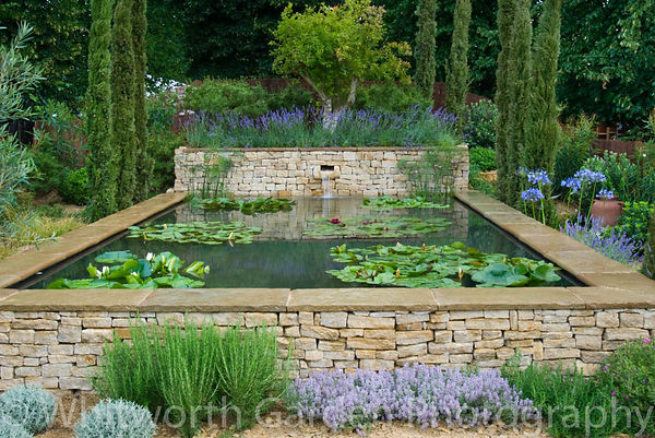 The Dorset Water Lily Garden - Romantic Charm at the RHS Hampton Court Flower Show. Designer: Claudia de Yong. © Rob Whitworth