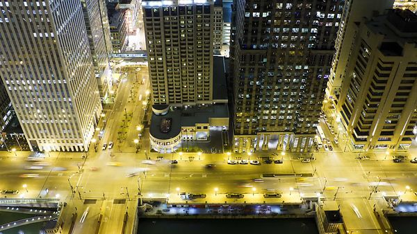 Bird's Eye: Twin Intersections By The Chicago River Lit Up