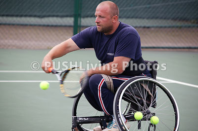 Disabled man playing wheelchair tennis