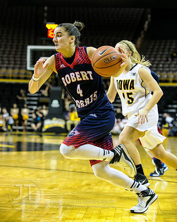 Robert Morris' Anna Niki Stamolamprou (4) drives to the basket against Iowa during the first half of play at Carver-Hawkeye A...