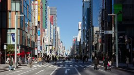 Medium Shot: Crowds Strolling Down A Colorful Pedestrian Street In Ginza