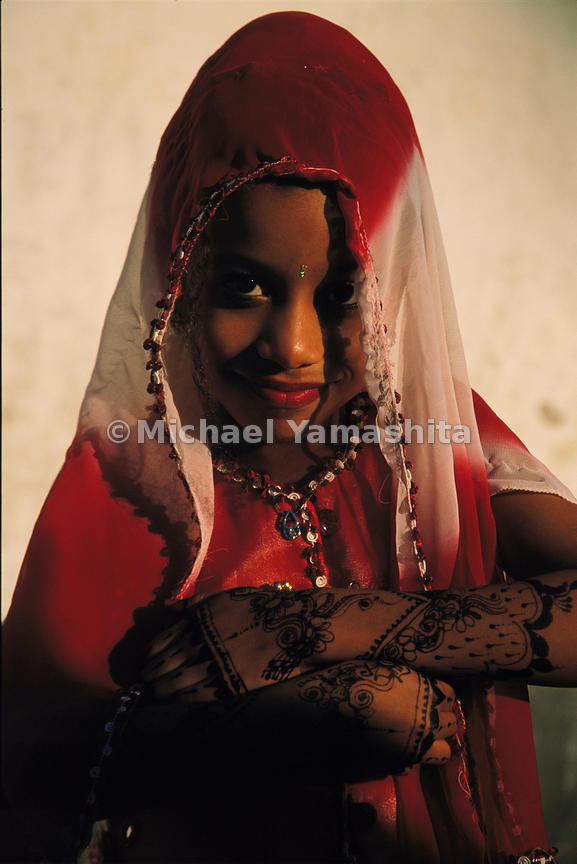Young muslim women on Pate are swathed in the traditional buibui that covers everything but their expressive faces.