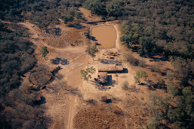 Aerial view of settler's outpost with surrounding area overgrazed by cattle and goats. Dry Chaco, Argentina. almost 80% of Dr...