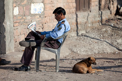 Construction site security guard and his dog, Jodhpur, Rajasthan, India