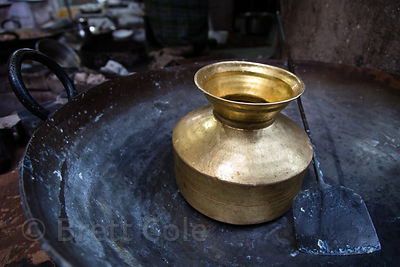 Striking bronze water pot in a sweets shop, Pushkar, Rajasthan, India