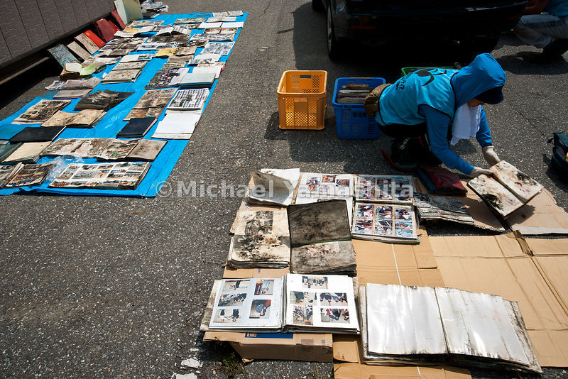 Photo rescue center. Restored photo albums, and other personal effects and memorabilia found in tsunami wreckage are displaye...